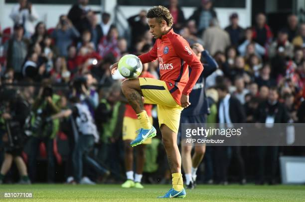 Paris SaintGermain's Brazilian forward Neymar warms up prior to the French L1 football match Paris SaintGermain vs En Avant Guingamp at the Roudourou...