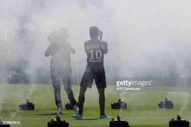 TOPSHOT Paris SaintGermain's Brazilian forward Neymar waves to the crowd during his presentation to the fans at the Parc des Princes stadium in Paris...