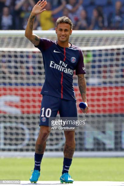 TOPSHOT Paris SaintGermain's Brazilian forward Neymar waves to the crowd during his presentation to the fans at the Parc des Princes stadium in Paris...