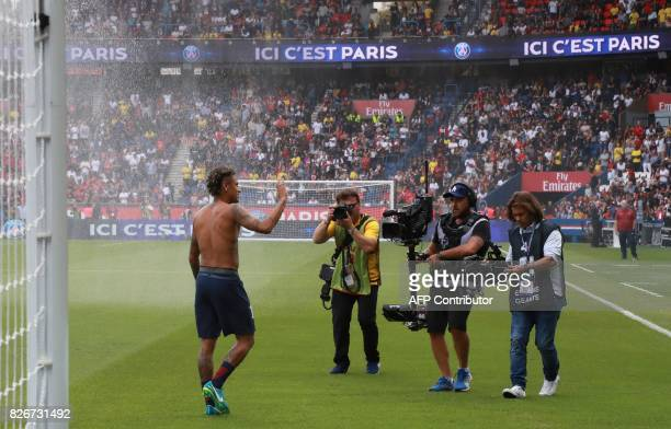Paris SaintGermain's Brazilian forward Neymar waves to the crowd during his presentation to the fans at the Parc des Princes stadium in Paris on...