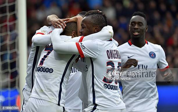 Paris SaintGermain's Brazilian midfielder Lucas celebrates with teammates after scoring a penalty kick during the French L1 football match between...