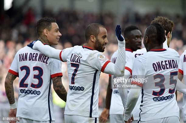 Paris SaintGermain's Brazilian midfielder Lucas celebrates with teammates after scoring a goalduring the French L1 football match between Guingamp...