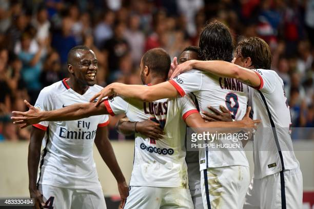 Paris SaintGermain's Brazilian midfielder Lucas celebrates with his teammates after scoring during the French Ligue 1 football match between Lille...