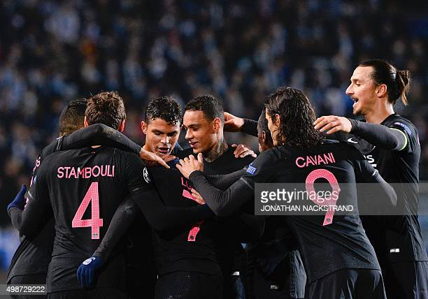 Paris SaintGermain`s Brazilian midfielder Lucas celebrates with his teammates after scoring a goal during the UEFA Champions League Group A secondleg...
