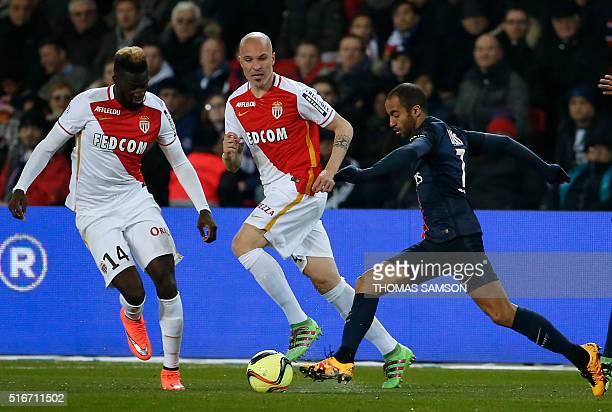 Paris SaintGermain's Brazilian midfielder Lucas Moura advances with the ball past AS Monaco's French midfielder Tiemoue Bakayoko and Italian defender...