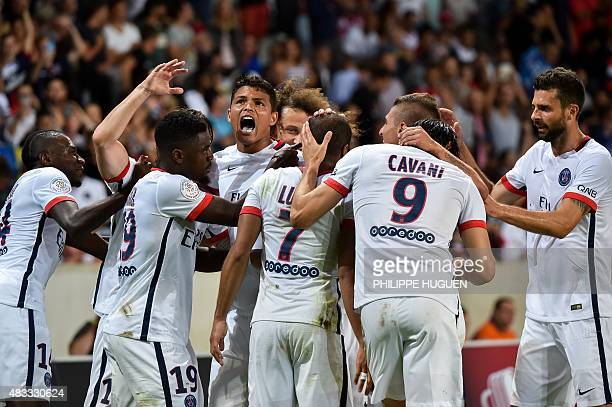 Paris SaintGermain's Brazilian midfielder Lucas Moura celebrates with his teammates after scoring during the French Ligue 1 football match between...