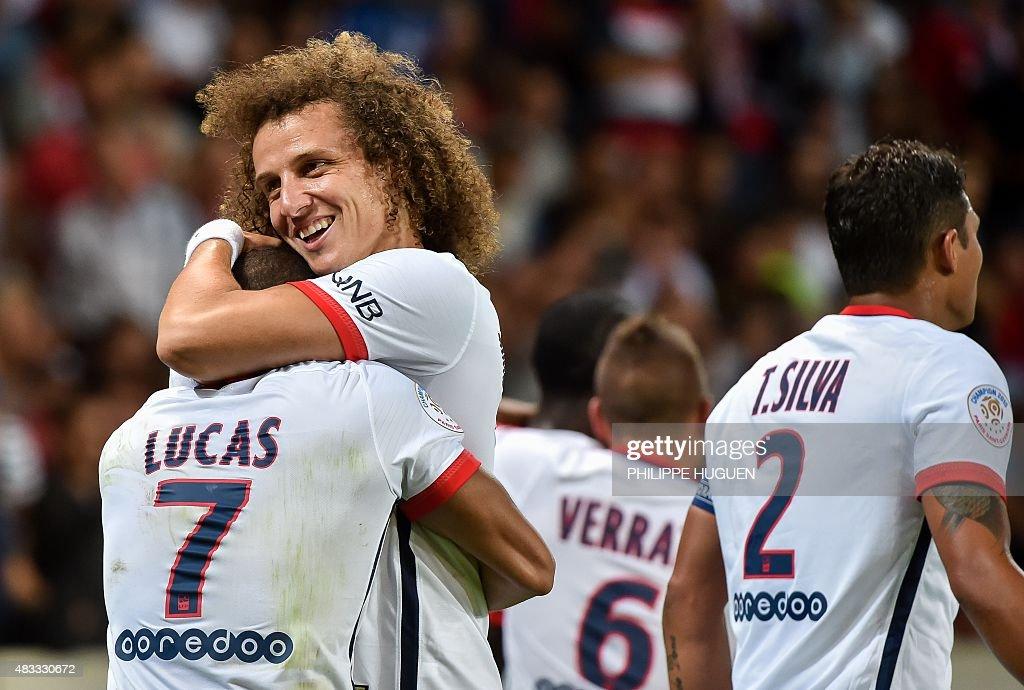 Paris Saint-Germain's Brazilian midfielder Lucas Moura (L) celebrates with Paris Saint-Germain's Brazilian defender David Luiz after scoring during the French Ligue 1 football match between Lille and PSG on August 7, 2015 at the Pierre Mauroy Stadium in Villeneuve d'Ascq.