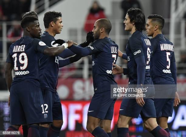 Paris SaintGermain's Brazilian midfielder Lucas Moura celebrates with teammates after scoring during the French Ligue 1 football match Dijon FCO...