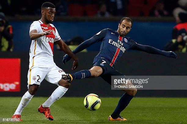 Paris SaintGermain's Brazilian midfielder Lucas Moura challenges Monaco's Brazilian defender Fabinho during the French L1 football match between...