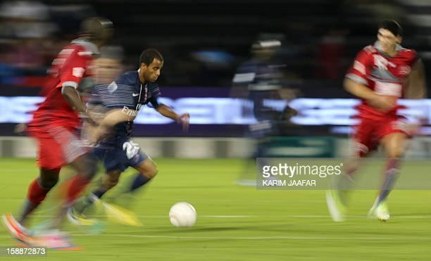 Paris SaintGermain's Brazilian midfielder Lucas Moura controls the ball during a friendly football match against Qatar's Lekhwiya in the Qatari...