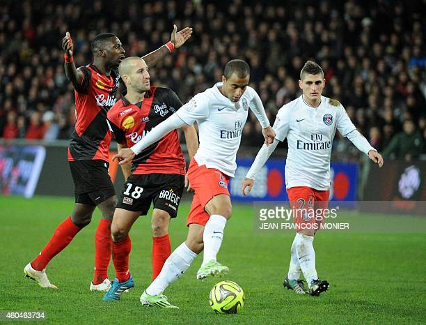 Paris SaintGermain's Brazilian midfielder Lucas Moura fights for the ball on December 14 2014 during a French L1 football match between EA Guingamp...