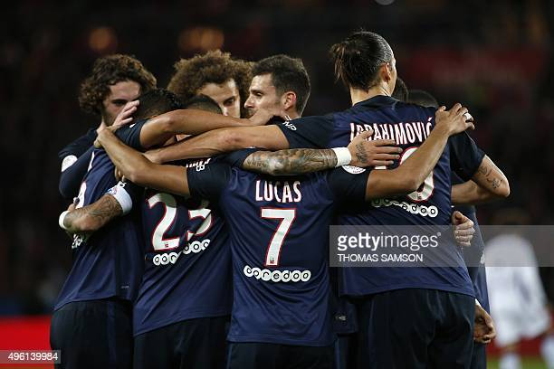 Paris SaintGermain's Brazilian midfielder Lucas Moura is congratulated by his teamates after scoring a goal during the French L1 football match...