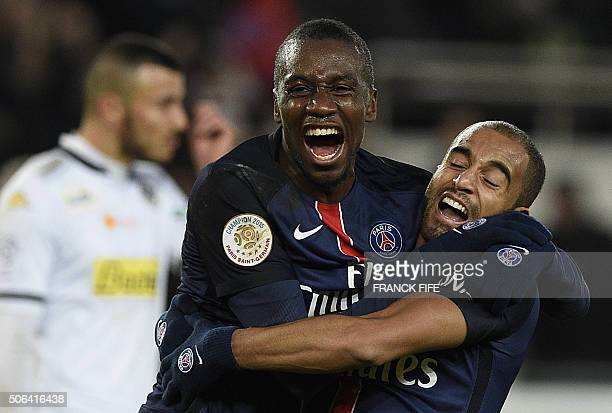 Paris SaintGermain's Brazilian midfielder Lucas Moura is congratulated by Paris SaintGermain's French midfielder Blaise Matuidi after scoring a goal...