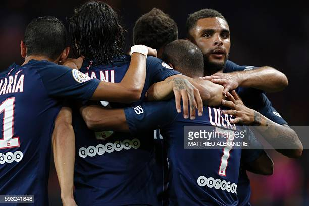Paris SaintGermain's Brazilian midfielder Lucas Moura is congratulated by his teammates after scoring during the French Ligue 1 Football match...