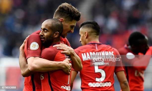 Paris SaintGermain's Brazilian midfielder Lucas Moura is congratuled by teammates after scoring a goal during the French L1 football match between...