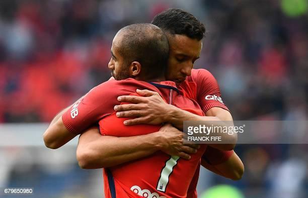 Paris SaintGermain's Brazilian midfielder Lucas Moura is congratuled by a teammate after scoring a goal during the French L1 football match between...