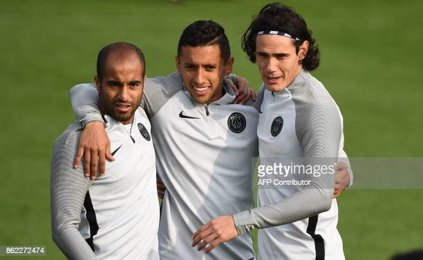 Paris SaintGermain's Brazilian midfielder Lucas Moura PSG's Brazilian defender Marquinhos and PSG's Uruguayan forward Edinson Cavani pose for a...