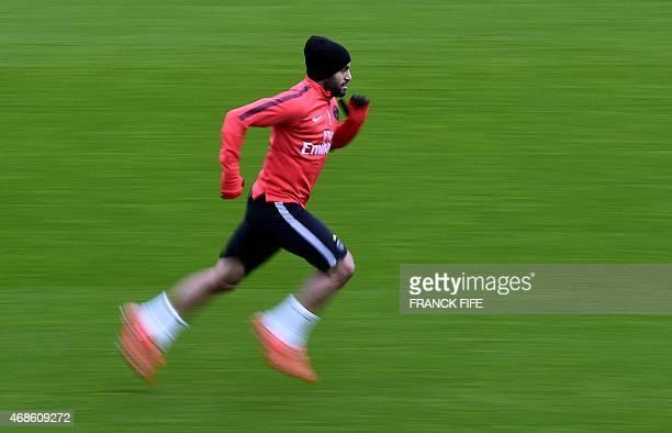 Paris SaintGermain's Brazilian midfielder Lucas Moura runs during a training session on April 4 2015 at the CampdesLoges in SaintGermainenLaye...