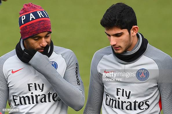 Paris SaintGermain's Brazilian midfielder Lucas Moura speaks with Portuguese forward Gonçalo Guedes during a training session on January 28 2017 in...