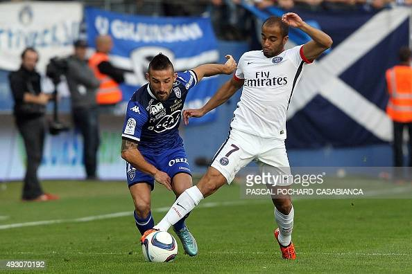 Paris SaintGermain's Brazilian midfielder Lucas Moura vies with Bastia's French defender Julian Palmieri during the L1 football match Bastia against...
