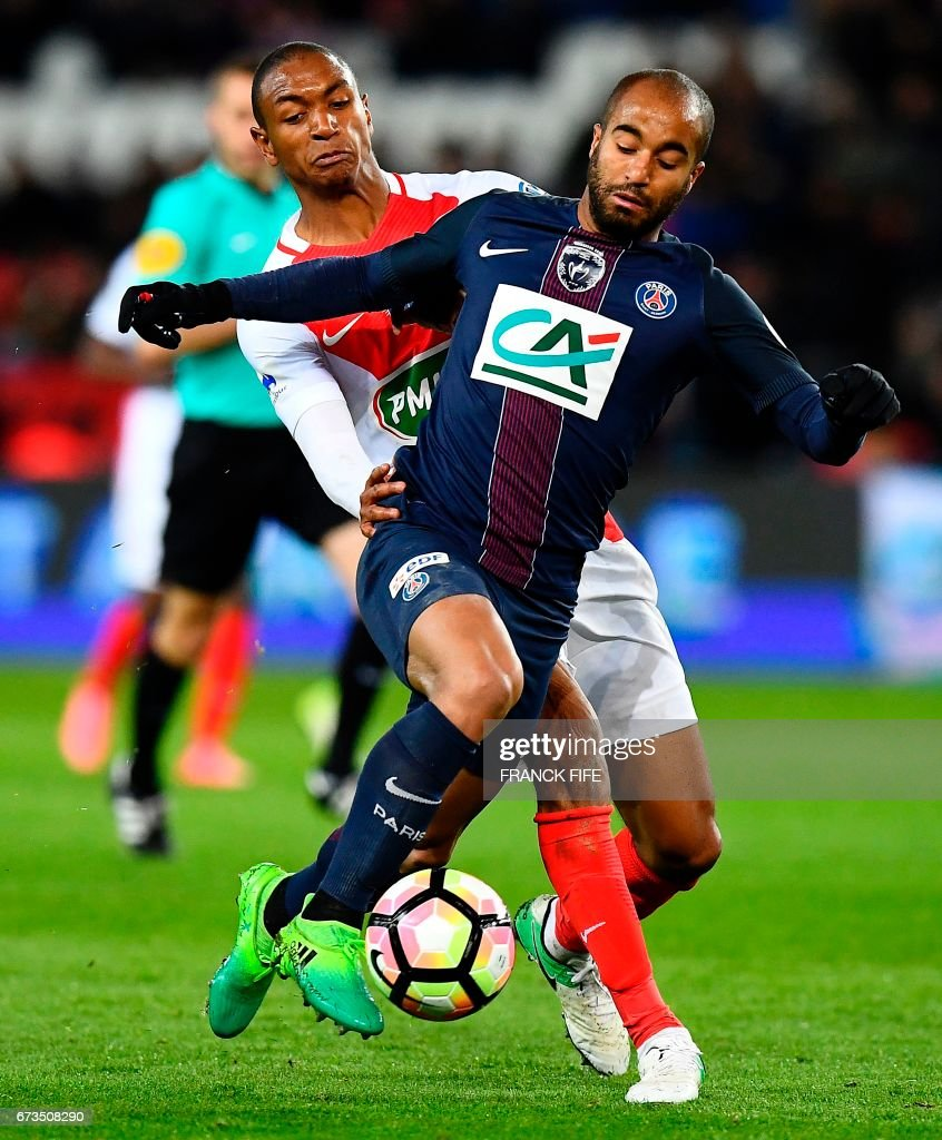 Paris Saint Germain s Brazilian midfielder Lucas Moura R vies