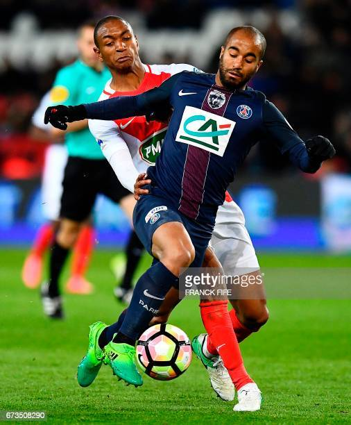 Paris SaintGermain's Brazilian midfielder Lucas Moura vies with Monaco's French defender Abdou Diallo during the French Cup semifinal match between...