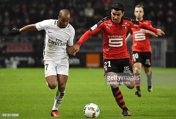 Paris SaintGermain's Brazilian midfielder Lucas Moura vies with Rennes' French midfielder Benjamin Andre during the French L1 football match between...