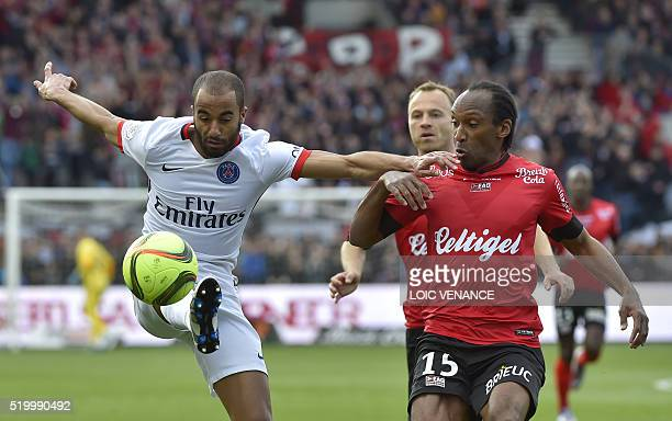 Paris SaintGermain's Brazilian midfielder Lucas vies with Guingamp's French defender Jeremy Sorbon during the French L1 football match between...