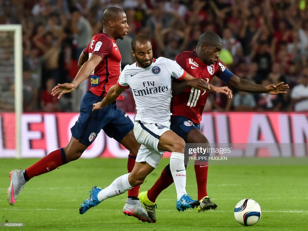 Paris Saint-Germain's Brazilian midfielder Lucas (C) vies with Lille's French midfielder Rio Mavuba (R) during the French L1 football match between Lille and PSG on August 7, 2015 at the Pierre Mauroy Stadium in Villeneuve d'Ascq.