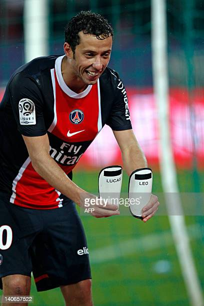 Paris SaintGermain's Brazilian midfielder Nene shows his two shin guards with his two sons' names Lucas and Leo written on them after scoring a goal...