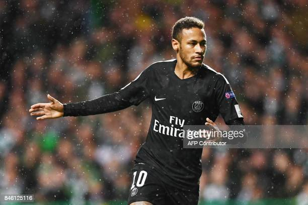 Paris SaintGermain's Brazilian striker Neymar celebrates after scoring the opening goal of the UEFA Champions League Group B football match between...