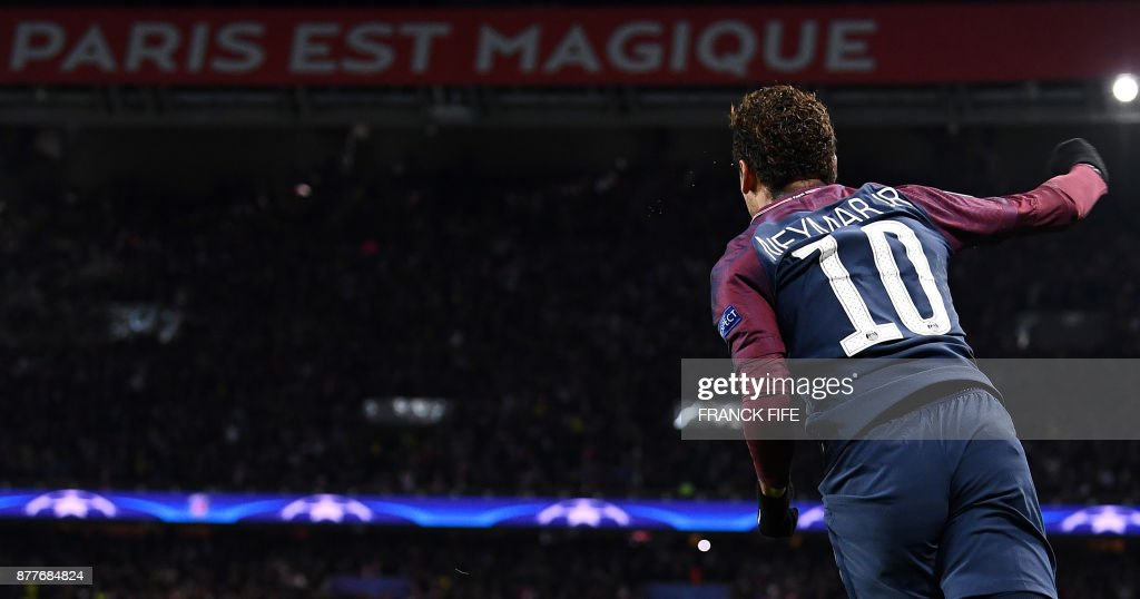 TOPSHOT - Paris Saint-Germain's Brazilian striker Neymar celebrates his second goal during the UEFA Champions League Group B football match between Paris Saint-Germain (PSG) and Glasgow Celtic at Parc des Princes Stadium in Paris on November 22, 2017. /