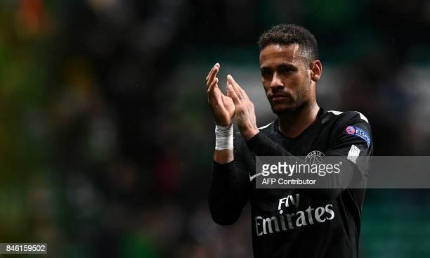 Paris SaintGermain's Brazilian striker Neymar celebrates their win on the pitch after the UEFA Champions League Group B football match between Celtic...