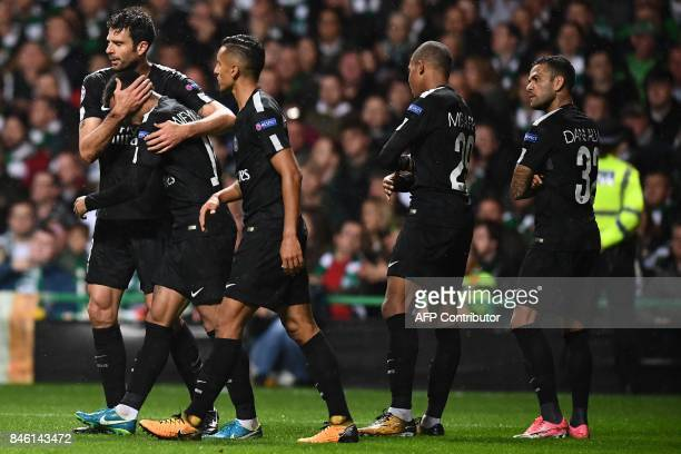 Paris SaintGermain's Brazilian striker Neymar celebrates with teammates after scoring the opening goal of the UEFA Champions League Group B football...