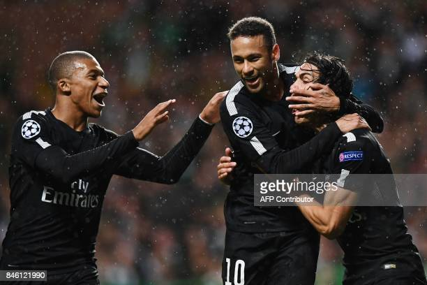 Paris SaintGermain's Brazilian striker Neymar celebrates with Paris SaintGermain's French striker Kylian Mbappe and Paris SaintGermain's Uruguayan...