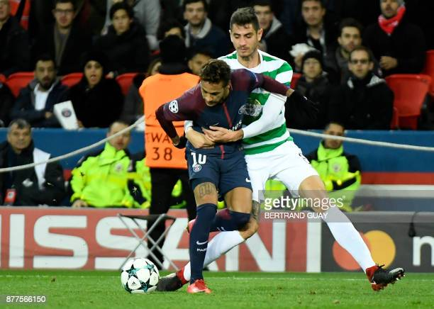 Paris SaintGermain's Brazilian striker Neymar fights for the ball with Celtic's Israeli midfielder Nir Bitton during the UEFA Champions League Group...