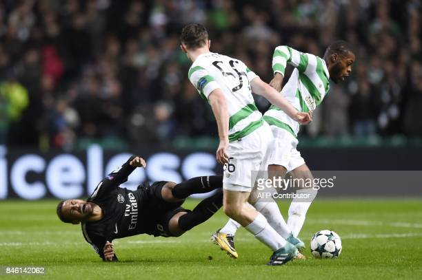 Paris SaintGermain's Brazilian striker Neymar is tackled by Celtic's Scottish defender Anthony Ralston and Celtic's French midfielder Olivier Ntcham...