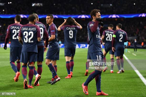 Paris SaintGermain's Brazilian striker Neymar reacts after scoring his team's second goal during the UEFA Champions League Group B football match...