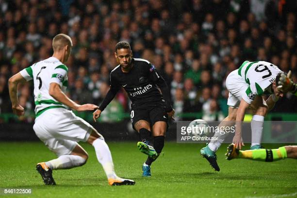 Paris SaintGermain's Brazilian striker Neymar shoots to score the opening goal of the UEFA Champions League Group B football match between Celtic and...