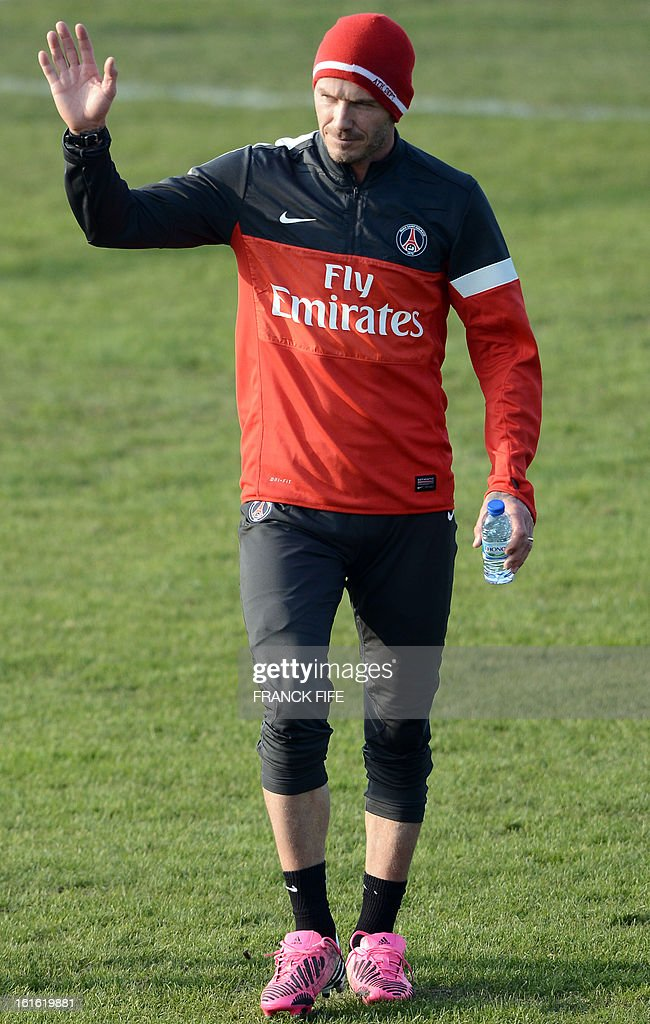 Paris Saint-Germain's British midfielder David Beckham leaves a training session on February 13, 2013 at the club's Camp des Loges training center in Saint-Germain-en-Laye, near Paris. Beckham, PSG's latest prized signing, is taking part in his first full training session today, with the view to possibly making his debut in February 17's L1 match at Sochaux. AFP PHOTO / FRANCK FIFE