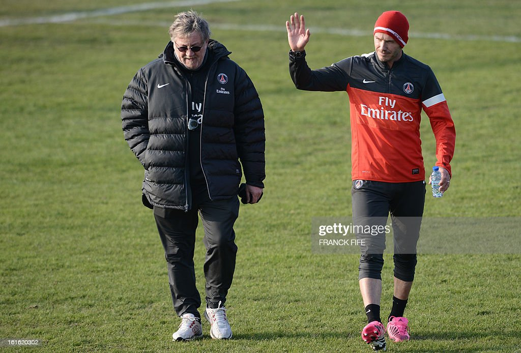 Paris Saint-Germain's British midfielder David Beckham (R) leaves with Italian physiotherapist Giovanni Mauri after a training session on February 13, 2013 at the club's Camp des Loges training center in Saint-Germain-en-Laye, near Paris. Beckham, PSG's latest prized signing, is taking part in his first full training session today, with the view to possibly making his debut in February 17's L1 match at Sochaux. AFP PHOTO / FRANCK FIFE