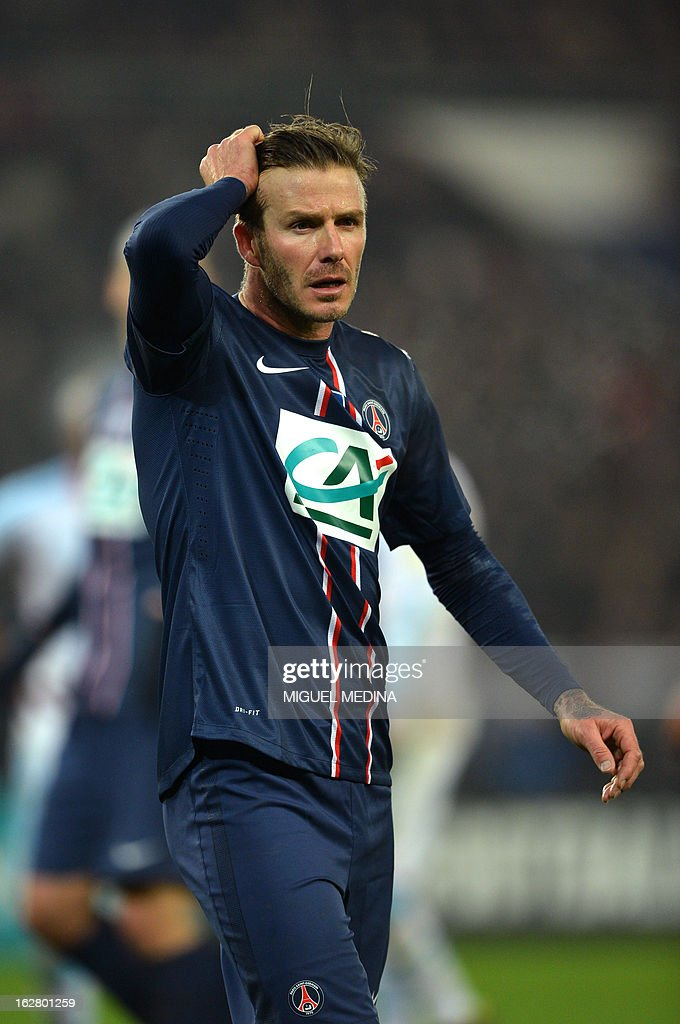 Paris Saint-Germain's British midfielder David Beckham reacts during the French Cup football match between Paris Saint Germain (PSG) vs Olympique de Marseille (OM) on February 27, 2013 at the Parc-des-Princes stadium in Paris.
