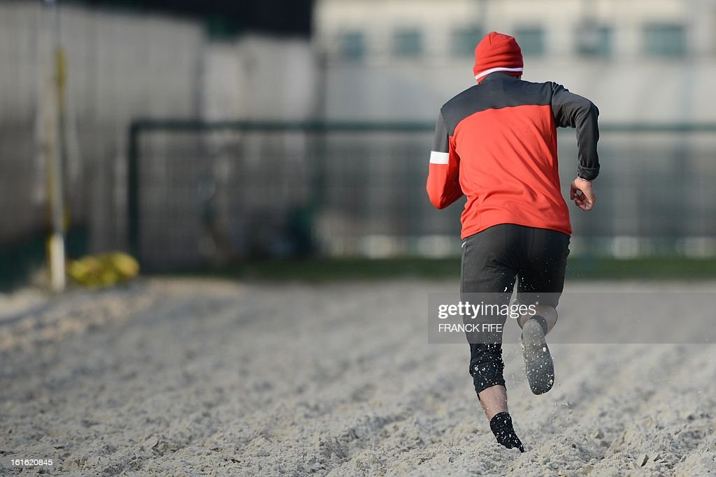 Paris Saint-Germain's British midfielder David Beckham runs in the sand during a training session on February 13, 2013 at the club's Camp des Loges training center in Saint-Germain-en-Laye, near Paris. Beckham, PSG's latest prized signing, is taking part in his first full training session today, with the view to possibly making his debut in February 17's L1 match at Sochaux.