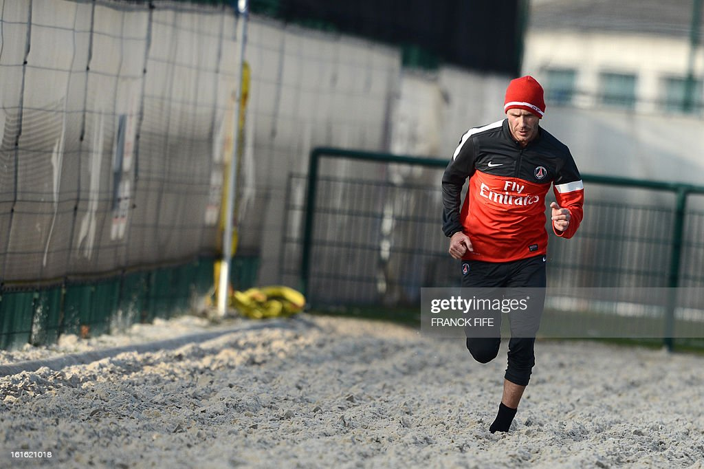 Paris Saint-Germain's British midfielder David Beckham runs in the sand during a training session on February 13, 2013 at the club's Camp des Loges training center in Saint-Germain-en-Laye, near Paris. Beckham, PSG's latest prized signing, is taking part in his first full training session today, with the view to possibly making his debut in February 17's L1 match at Sochaux. AFP PHOTO / FRANCK FIFE