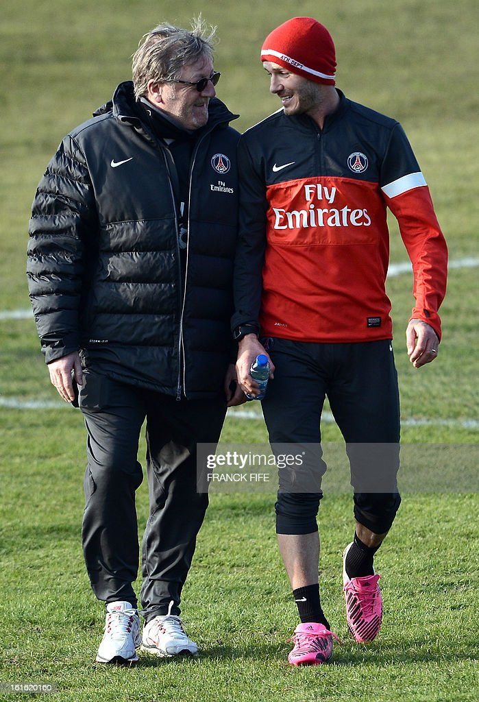 Paris Saint-Germain's British midfielder David Beckham (R) speaks with Italian physiotherapist Giovanni Mauri as he leaves a training session on February 13, 2013 at the club's Camp des Loges training center in Saint-Germain-en-Laye, near Paris. Beckham, PSG's latest prized signing, is taking part in his first full training session today, with the view to possibly making his debut in February 17's L1 match at Sochaux.