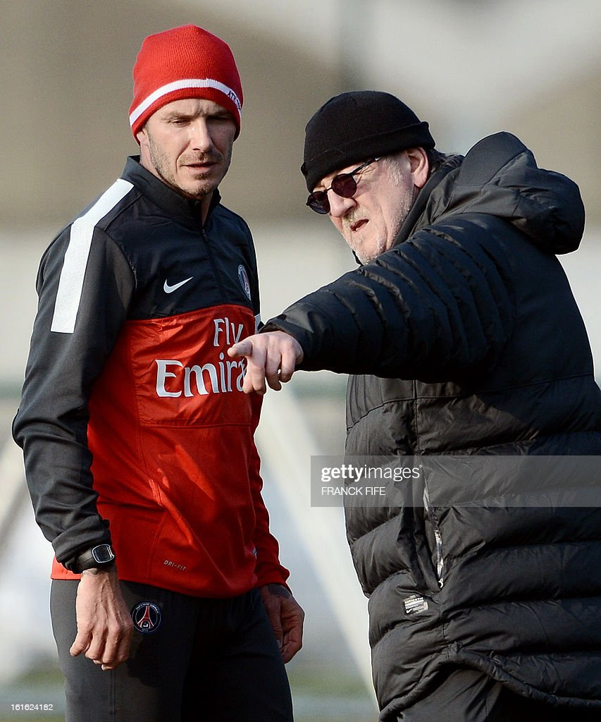 Paris Saint-Germain's British midfielder David Beckham speaks with physiotherapist Giovanni Mauri (R) during a training session on February 13, 2013 at the club's Camp des Loges training center in Saint-Germain-en-Laye, near Paris. Beckham, PSG's latest prized signing, is taking part in his first full training session today, with the view to possibly making his debut in February 17's L1 match at Sochaux.
