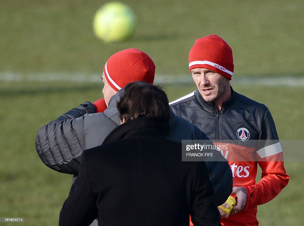 Paris Saint-Germain's British midfielder David Beckham (R) speaks with Italian coach Carlo Ancelotti (L) and Brazilian sport director Leonardo durng a training session on February 13, 2013 at the club's Camp des Loges training center in Saint-Germain-en-Laye, near Paris. Beckham, PSG's latest prized signing, is taking part in his first full training session today, with the view to possibly making his debut in February 17's L1 match at Sochaux. AFP PHOTO / FRANCK FIFE