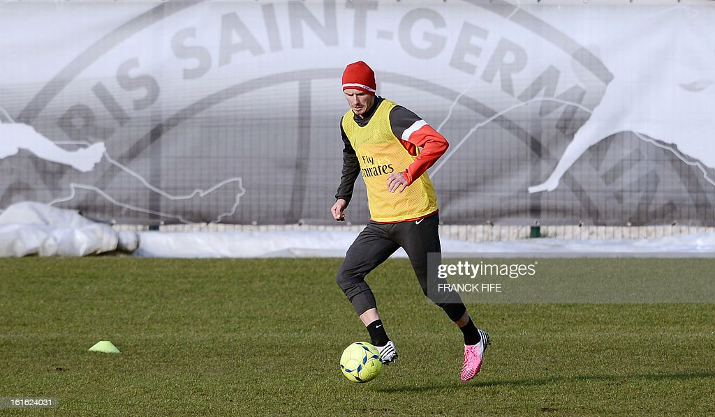 Paris Saint-Germain's British midfielder David Beckham takes part in a training session on February 13, 2013 at the club's Camp des Loges training center in Saint-Germain-en-Laye, near Paris. Beckham, PSG's latest prized signing, is taking part in his first full training session today, with the view to possibly making his debut in February 17's L1 match at Sochaux.