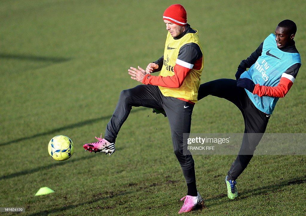 Paris Saint-Germain's British midfielder David Beckham (L) takes part in a training session on February 13, 2013 at the club's Camp des Loges training center in Saint-Germain-en-Laye, near Paris. Beckham, PSG's latest prized signing, is taking part in his first full training session today, with the view to possibly making his debut in February 17's L1 match at Sochaux.
