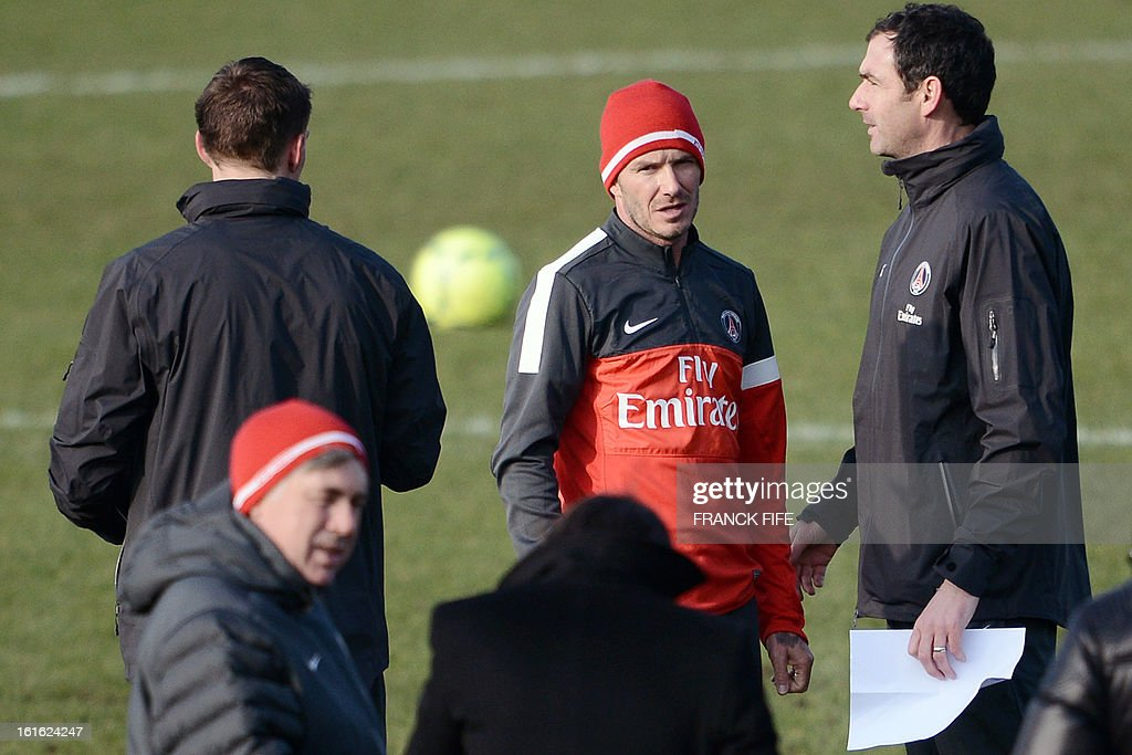 Paris Saint-Germain's British midfielder David Beckham (C) takes part in a training session in front of Italian coach Carlo Ancelotti (L) and Brazilian sport director Leonardo (C) during a training session on February 13, 2013 at the club's Camp des Loges training center in Saint-Germain-en-Laye, near Paris. Beckham, PSG's latest prized signing, is taking part in his first full training session today, with the view to possibly making his debut in February 17's L1 match at Sochaux. AFP PHOTO / FRANCK FIFE